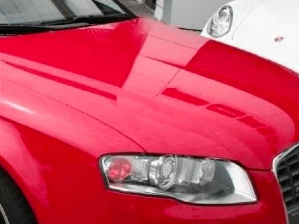 red car hail damage after fixed by StormWise
