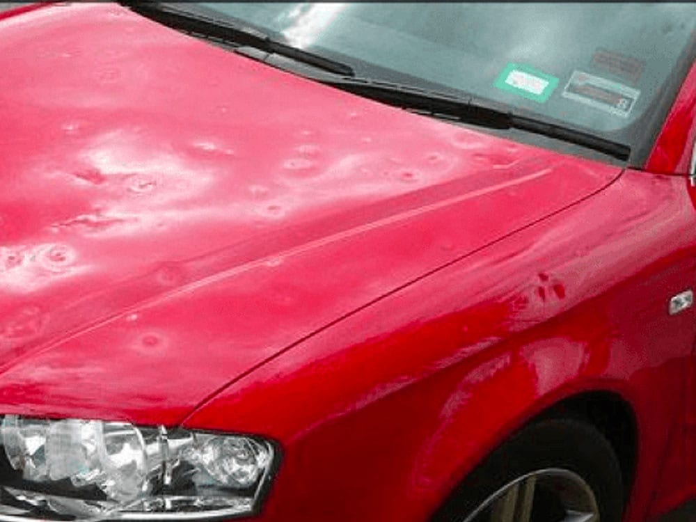 red car hail damage before fixed by StormWise