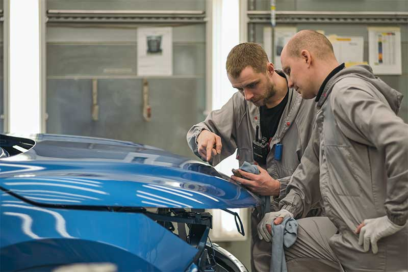 auto hail repair employees check quality