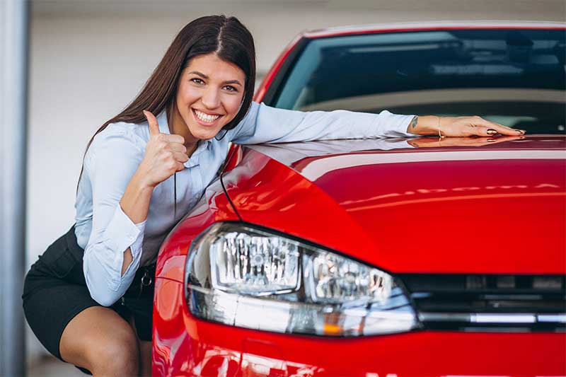 young women happy about repaired hail damage for her car