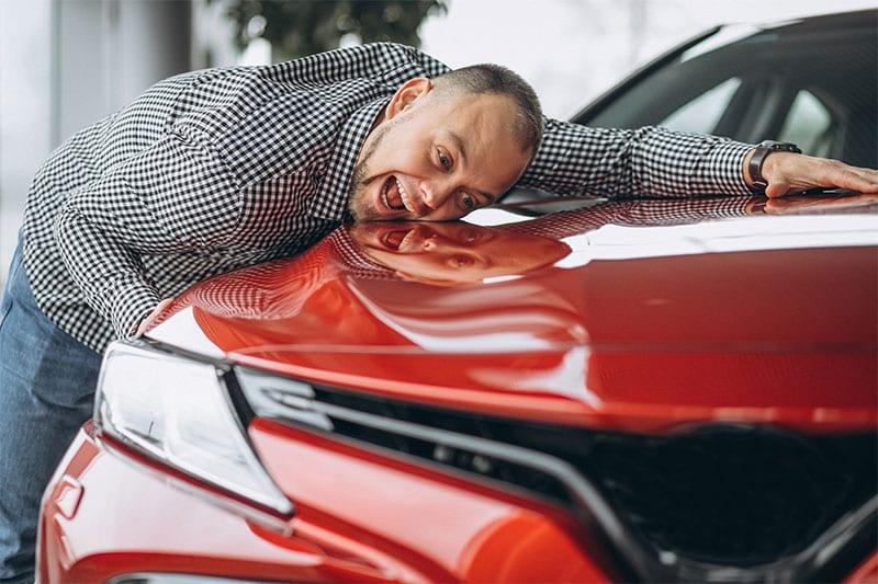 man hug car after auto hail repair in Aurora
